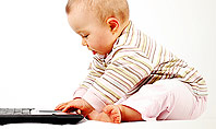 Small Baby with Laptop Presentation Template