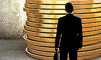 Businessman Standing in Front of Stack of Coins Presentation Template