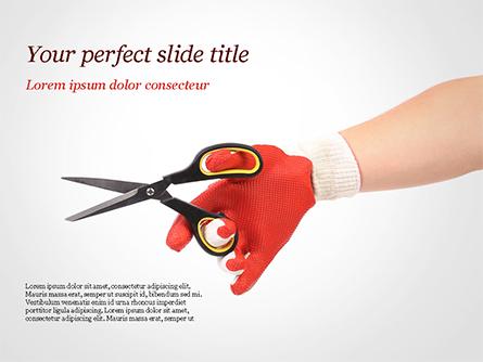 Hand In Glove Holding Scissors Presentation Template, Master Slide