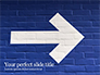 Arrow Direction Sign Painted on Blue Wall slide 1