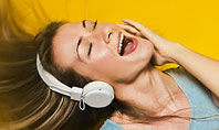 Happy Woman Listening Music in Headphones and Dancing Presentation Template