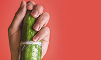 Cucumber in a Man Hand Presentation Template