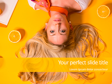 Portrait of Blonde Girl Lying on Yellow Background with Oranges Presentation Template, Master Slide