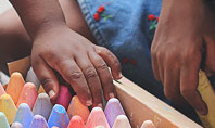 Toddlers are Playing with Full Box of Colored Chalk Presentation Presentation Template