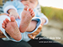 Closeup View of Baby's Toes on Bare Feet Presentation slide 1