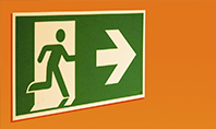 Emergency Exit Sign on Orange Background Presentation Presentation Template