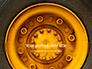 Closeup Photo of Yellow Vehicle Wheel with Tire Presentation slide 1