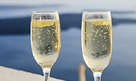 Two Prosecco Glasses Against a Sea Presentation Presentation Template