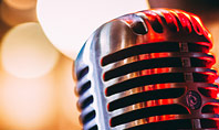 Old Fashion Microphone Against Bokeh Background Presentation Presentation Template