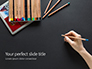 Hand with Blue Pencil Against Black Table Presentation slide 1