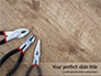 Pliers and Wire Cutters on Wooden Fool Presentation slide 1