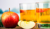 Red Apple and Two Glasses of Apple Juice Presentation Presentation Template