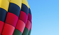 Colorful Hot Air Balloon in Blue Sky Presentation Presentation Template