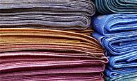 Pile of Colored Area Rugs Presentation Presentation Template