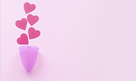 Menstrual Cup with Hearts on Pink Background Presentation Presentation Template