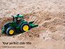 Toy Tractor in Sand Presentation slide 1