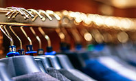 Row of Men Suit Jackets on Hangers Presentation Presentation Template