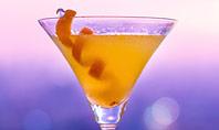 Martini Glass Against Blurred Cityscape Presentation Presentation Template