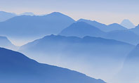 Mountain Peaks in Blue Morning Fog Presentation Presentation Template
