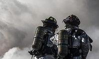 Two Firefighters Standing Beside Smoke Presentation Presentation Template