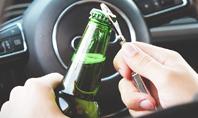 A Driver Holding Alcoholic Bottle Presentation Presentation Template