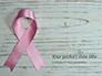 Breast Cancer Pink Ribbon on Wooden Background Presentation slide 1