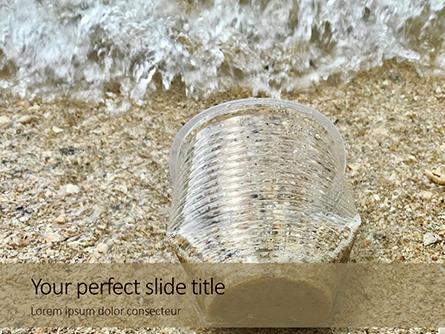 Used Plastic Cup On Sand Presentation Presentation Template, Master Slide