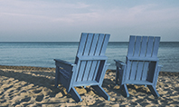 Two Blue Adirondack Chairs on the Beach Presentation Presentation Template