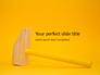 Wooden Mallet Hammer on Yellow Background Presentation slide 1