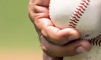 Man Holding Two Baseballs Presentation Presentation Template