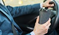 A Businessman Drinking Coffee while Driving a Car Presentation Presentation Template