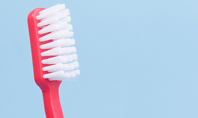 Toothbrush on Blue Background Presentation Presentation Template
