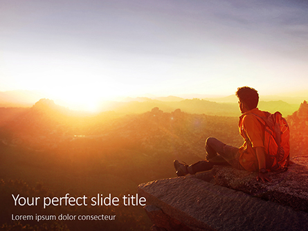 Man Sitting on Edge Cliff Facing Sunset Presentation Presentation Template, Master Slide