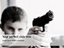 Young Boy Holding a Toy Gun Presentation slide 1