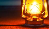 Lighted Kerosene Lantern on Ground Presentation Presentation Template