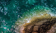 Aerial View of Sea Waves and Fantastic Rocky Coast Presentation Presentation Template