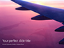 Airplane Wing with Sunrise in Light Flare Presentation slide 1