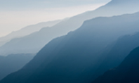 Panoramic Mountains in Blue Mist Presentation Presentation Template