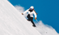 Skier Skiing Downhill During Sunny Day in High Mountains Presentation Presentation Template