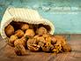 Walnuts Scattered from Burlap Bag on Wooden Table Presentation slide 1