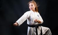 A Martial Arts Woman in White Kimono with Black Belt Presentation Presentation Template
