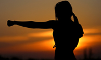 Young Woman Training Karate on Sunset Presentation Presentation Template