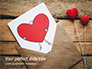 Love Letter Envelope with Red Heart on Wooden Table Presentation slide 1