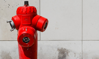 A Deep Red Fire Hydrant in Front of a Wall Presentation Presentation Template