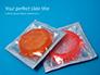 Two Condom Packs on a Blue Background Presentation slide 1