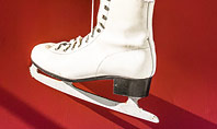Hanged Pair of White Leather Figure Skates on Red Wall Presentation Presentation Template
