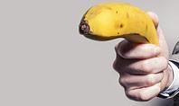 Man in a Suit Holding Banana Like a Gun Presentation Presentation Template