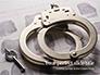 Sliver Handcuffs Lying on Top of Fingerprint Sheets Presentation slide 1
