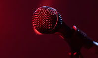 Microphone on a Stand Up Comedy Stage Presentation Presentation Template