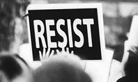A Protester Raised Banner with Resist Caption Presentation Presentation Template